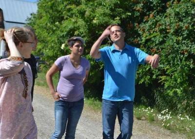 women and man walking in sunshine