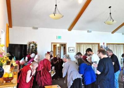 monastics and lay people bow to eachother