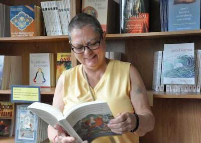 Smiling woman looking at book