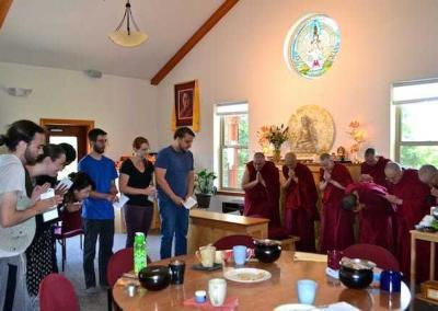 The group makes a food offering to the sangha.
