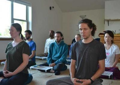 Group of young adults meditationg