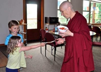 Cora gives Ven. Chodron a gift.