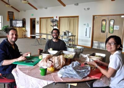 smiling group peeling apples
