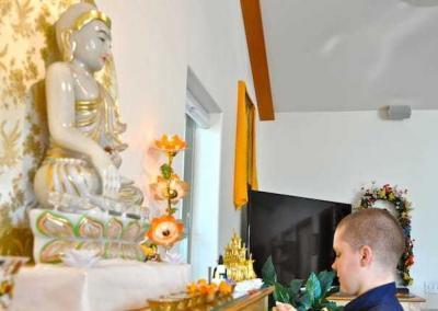 Lay woman with Buddha statue