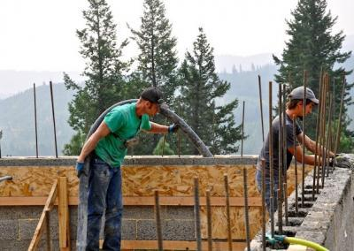 Brandon lines up the rebar and the concrete lineman fills the block.