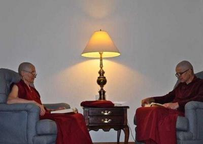 monk and nun sitting in easy chairs