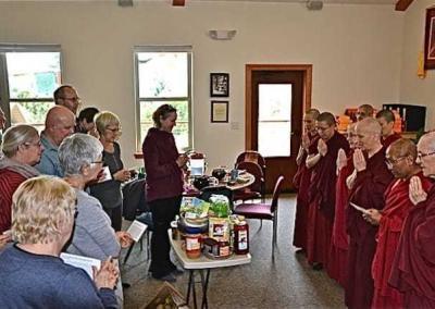 laypeople offer food to monastics
