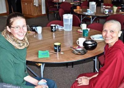 nun and lay woman sitting at table