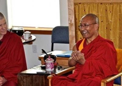 Smiling monk answers questions