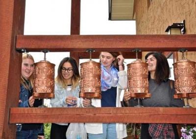 Teens with prayer wheels