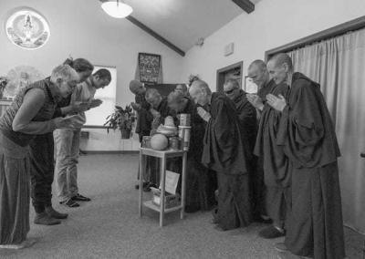monastics and lay people bow to each other