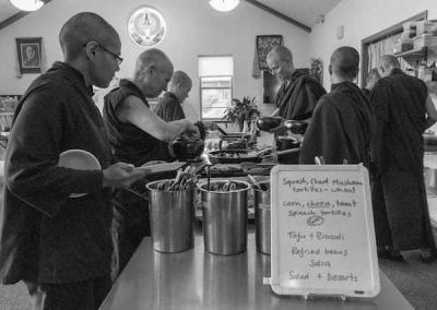 monastics in serving line