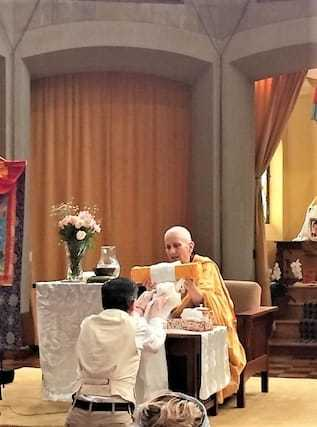 nun receives gift from lay person