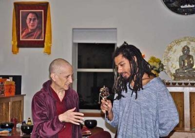 nun and lay man with prayer wheel