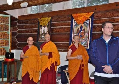nuns standing in meditation hall
