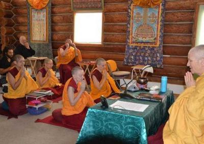 nuns practicing in meditation hall