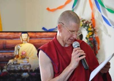 monk with mic reading