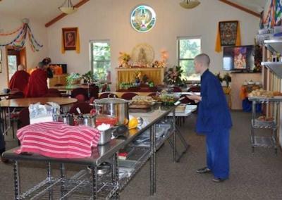 woman in blue preparing buffet