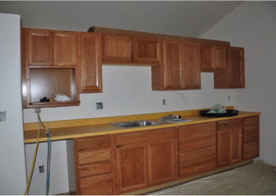 The cottage cabinets resemble those in Chenrezig Hall.