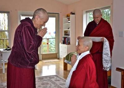 nun and monk offer scarves to nun