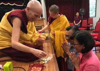 The Buddhist Gem Fellowship retreat concludes with Ven. Chodron distributing mani pills to joyful participants.