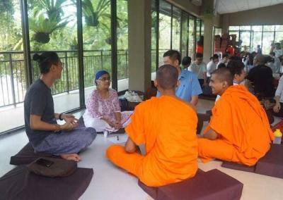 monks and lay people in small discussion groups.