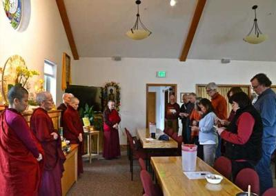 lay people bowing to monastics