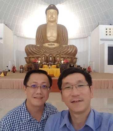 laymen selfie with Buddhist statue