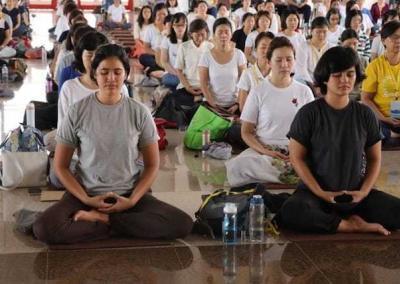 lay women sitting in meditation
