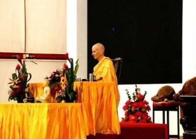 Nun meditating on stage