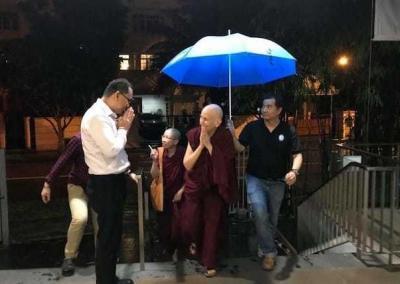 Nun and lay man with umbrella