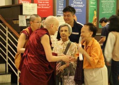Nun greets elderly lay woman