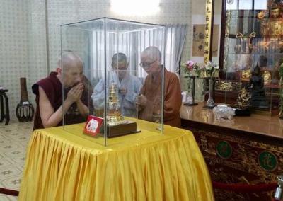 nuns looking at relic