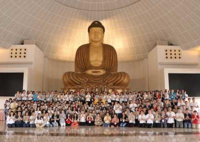 Group photo with Buddhist statue