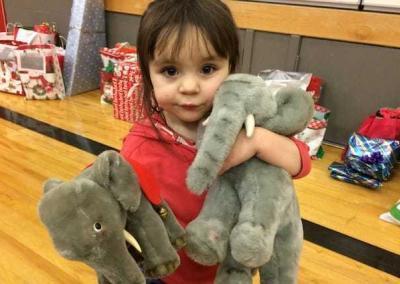 child with stuffed animals