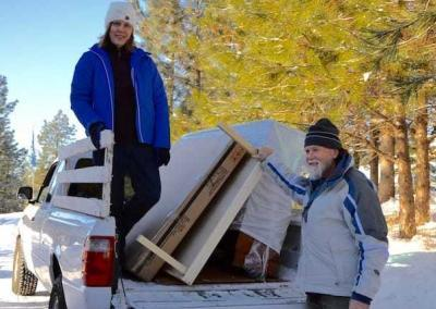 Dwight and Janet help move some of the furniture in to Prajna Cottage.