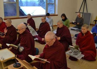 monastics and lay people sitting and reciting