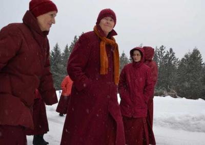 nuns standing in snowy field