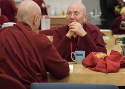 Friendships are born as nuns from different parts of the world connect. Here, German nun Ven. Thubten Chodroen chats with American Ven. Palmo.
