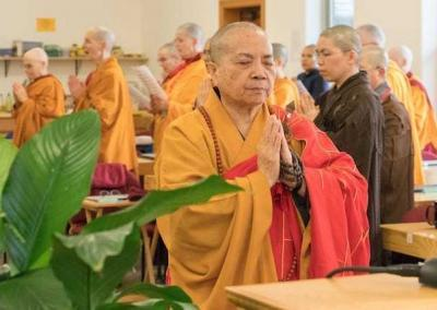 Venerable Master Wuyin makes an incense offering.