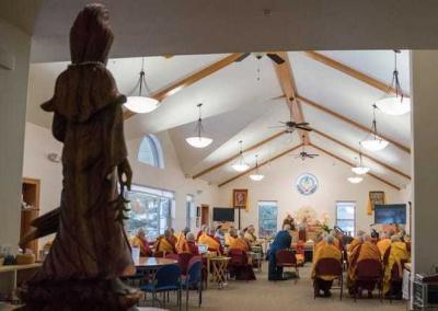 Venerable Kwan Yin - Buddha of Compassion - watches as the teachings begin.