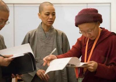 Vens. Jenkir and Jenqu from LIBS and Ven. Damcho confer on the schedule.