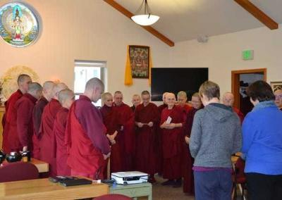 A huge sangha accepts a food offering.