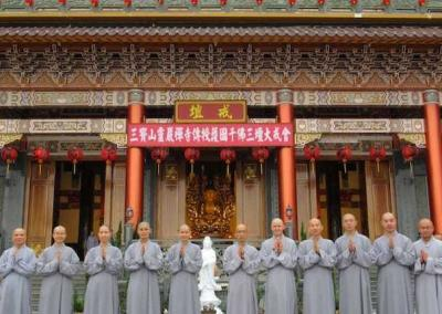 Upon arrival in Taiwan, Vens. Losang and Pende visit Dharma Drum Mountain, one of the four leading Buddhist organizations in Taiwan, where they don Chinese robes.