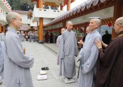 Arriving at Lingyan Temple, Ven. Pende is measured for the outer robes that the temple will provide.