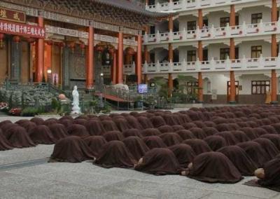 rows of monastics bowning