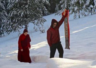 Man holding thangka with nun