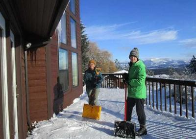 During the break, Kathy and Nicole help with shoveling and getting some fresh air.