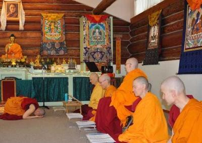 One by one, monastics go before the abbess. Ven. Pema, at her first varsa, bows to the abbess.