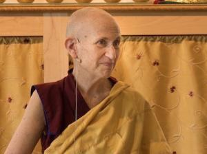 Buddhist nun in gold background